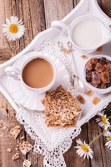 Coffee with milk and cookies .healthy summer breakfast.