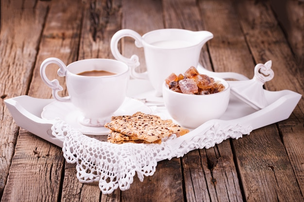 Coffee with milk and cookies . romantic breakfast