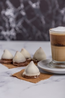 Coffee with milk and dulce de leche cones with sweet chocolate cones