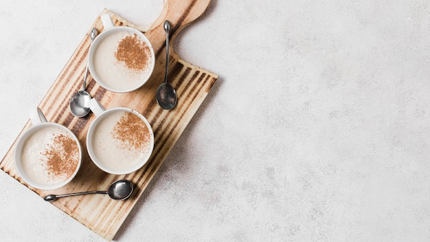 Coffee with milk on wooden board with copy space
