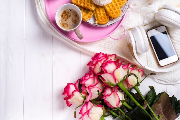 Coffee with waffles and roses. valentine's day or 8 march