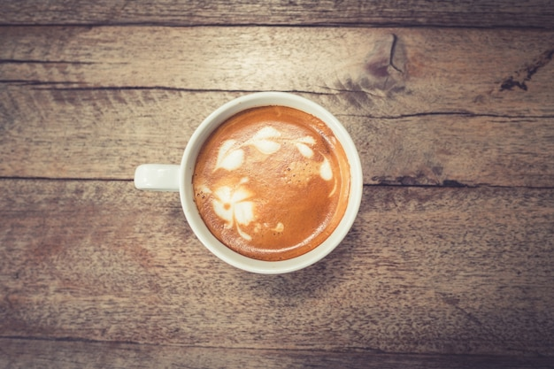 Coffee on wood table background with space.