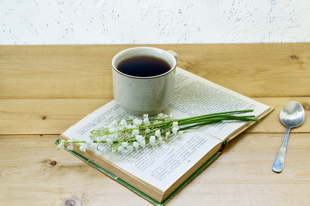 Coffee on a wooden background and flowers.