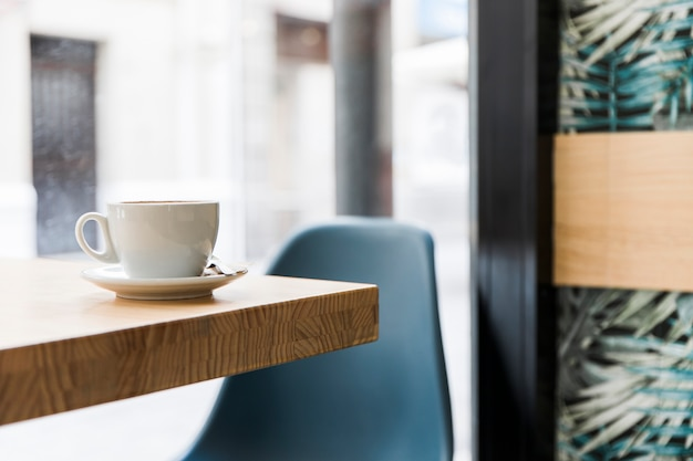 Coffee on wooden table in restaurant