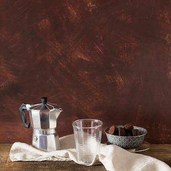 Coffeepot and chocolate truffle