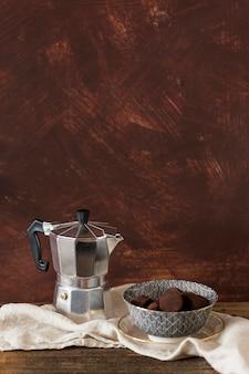 Coffeepot and chocolate truffles