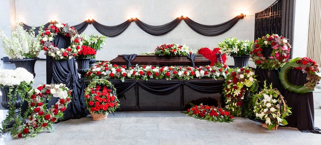 The coffin is decorated with various flowers