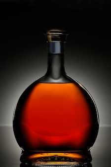 Коньяк в овальной бутылке