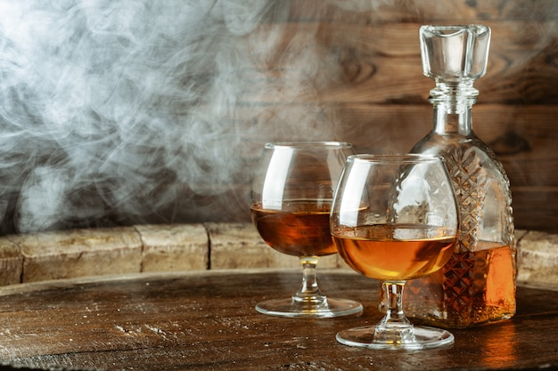 Cognac or whiskey in glasses on rustic