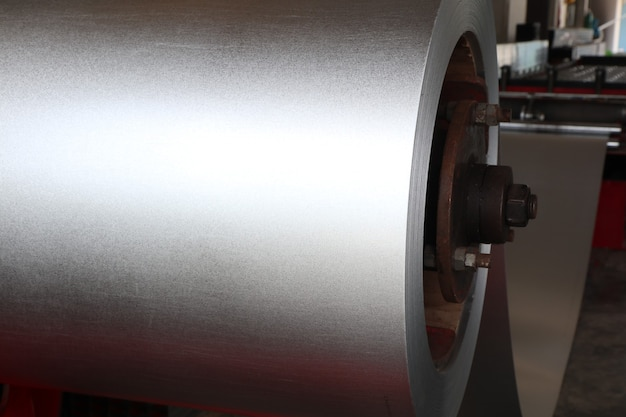 Coiled steel in metal sheet rolling machine ; for tile manufacturing ; industrial equipment background