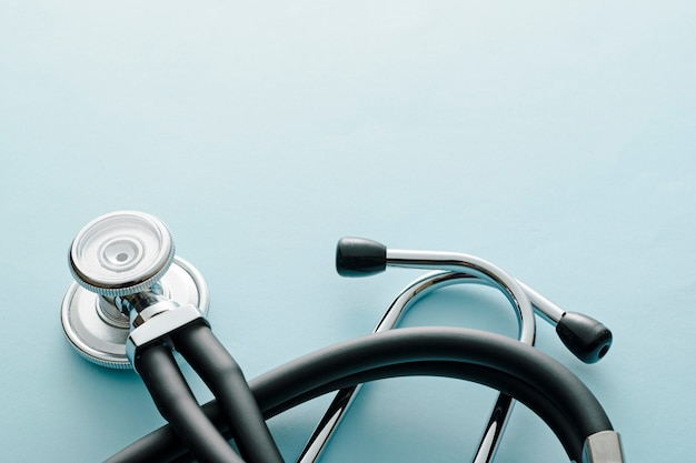 Coiled stethoscope on blue table