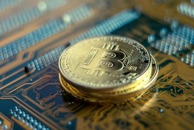Coin bitcoin on the electronic board. mining cryptocurrency