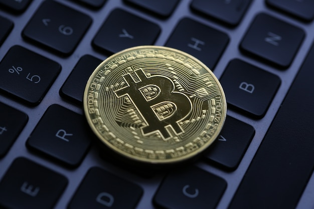 Coin crypto currency bitcoin lies on the keyboard