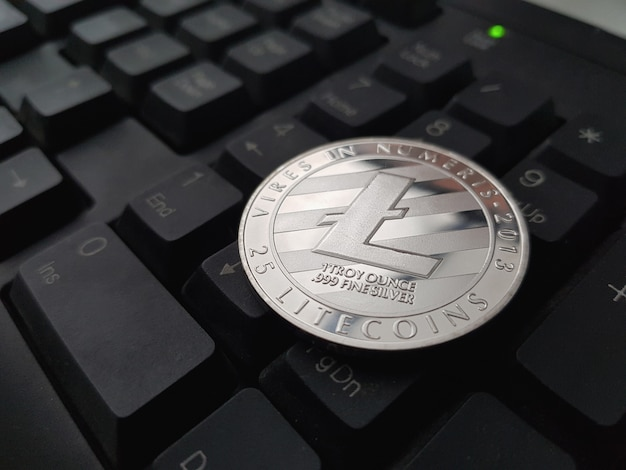 Coin crypto currency litecoin lies on the keyboard