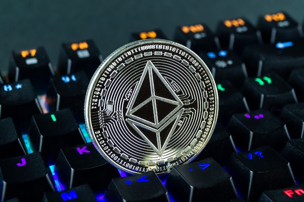 Coin cryptocurrency ethereum classic close - up of the colour - coded keyboard