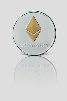 Coin ethereum is reflected on a glossy white surface. cryptocurrency and blockchain trading concept.