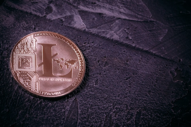 Coin litcoin ltc on concrete with copy space