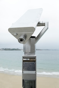 Coin operated telescope in a beach