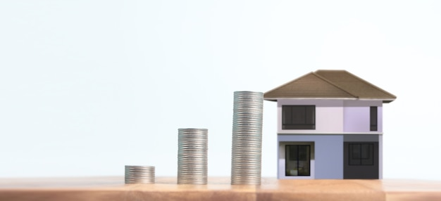 Coin stack house model savings plans for housing. home and real estate concept