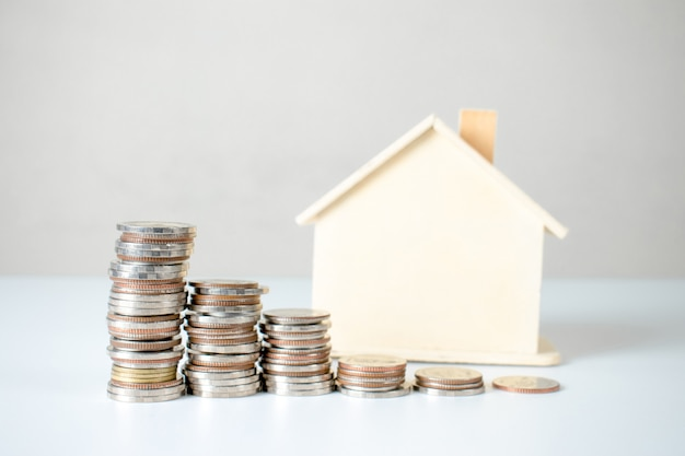 Coin stack and house plans. property investment and house mortgage financial .