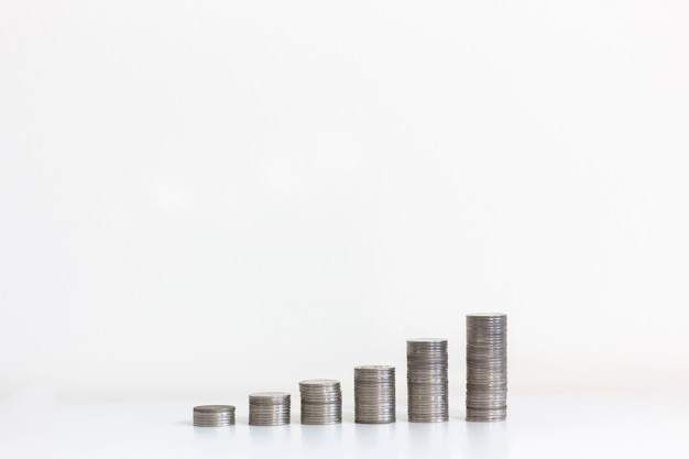 Coin stacks on a white background investment financial concept