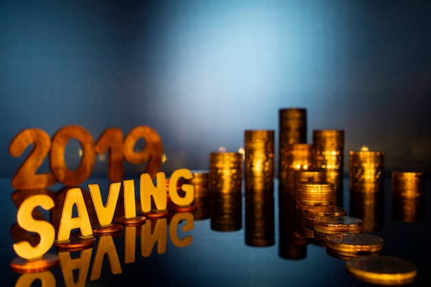 Coins arrows with a saving word for finance and business concept, saving money concept.