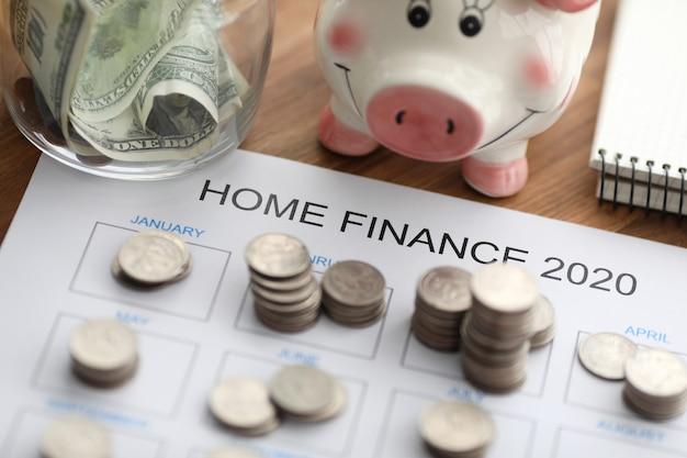 Coins, bills and piggy bank