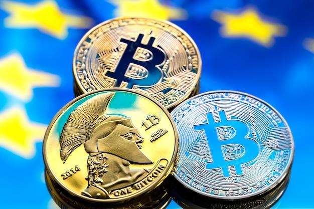 Monete bitcoin, sullo sfondo dell'europa e della bandiera europea