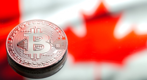 Coins bitcoin over canada flag, concept of virtual money, close-up. conceptual image.
