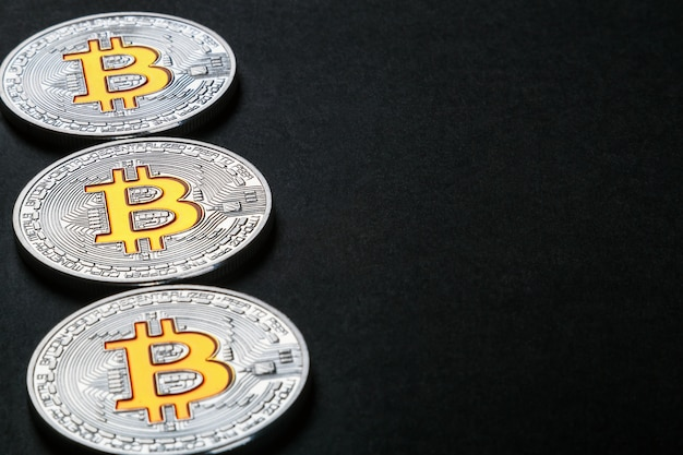 Coins of the bitcoin cryptocurrency on black