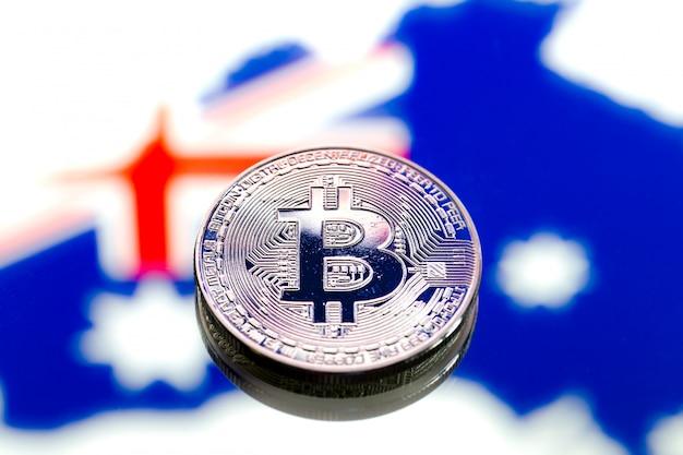 Монеты биткойн над австралией и австралийский флаг, концепция виртуальных денег, крупный план. концептуальное изображение.