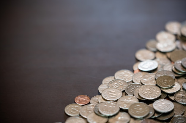 Coins and copy space piled up on the desk.