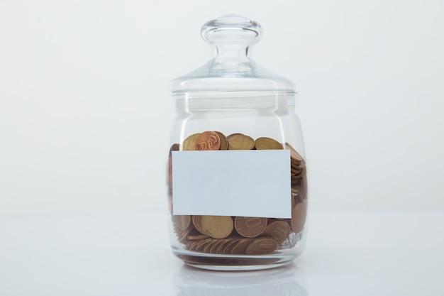 Coins in a glass bank with space for text. savings concept