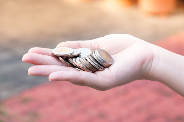 Coins in hands saving,donation investment fund financial support charity  dividend market  house stock trust wealthy giving planned accounting collection debt banking roi