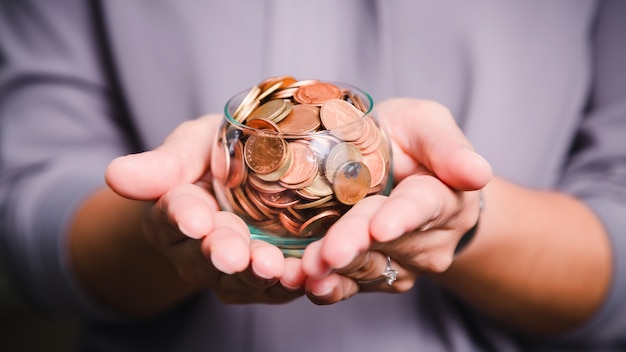 Coins in hands. saving money concept