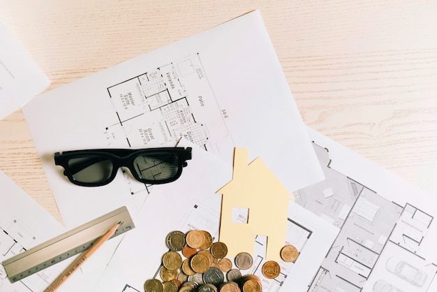 Coins and house with glasses