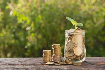 Coins in jar with money stack step growing money, Concept finance business