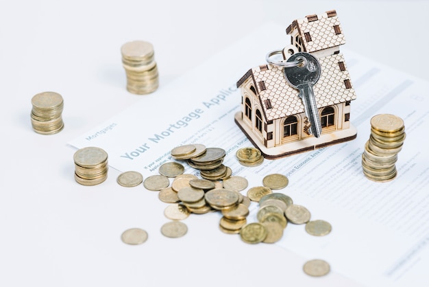 Coins and keys on mortgage application