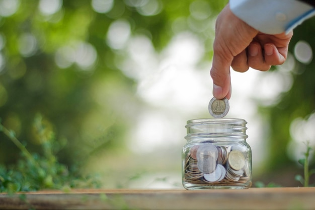 Coins money in jar for saving money concept