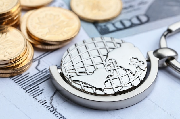Coins, paper money and globe on white statistic form background