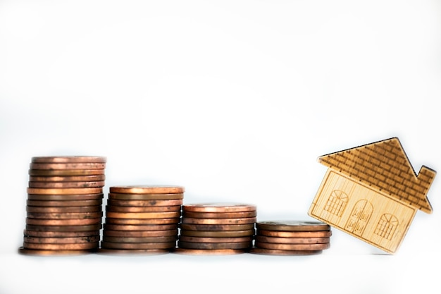 Coins saving setting stairs up to house model for concept investment mortgage loan finance and