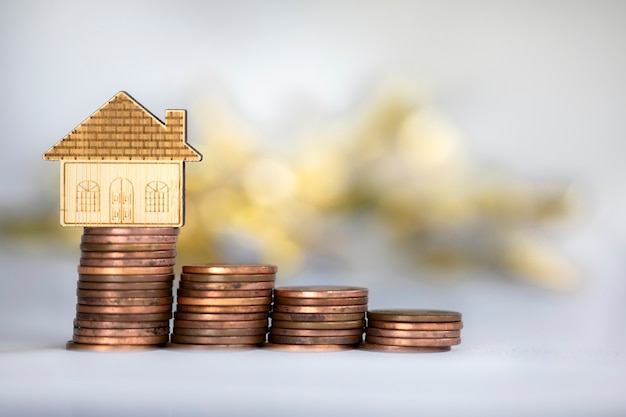 Coins saving setting stairs up to house model for concept investment mortgage loan finance