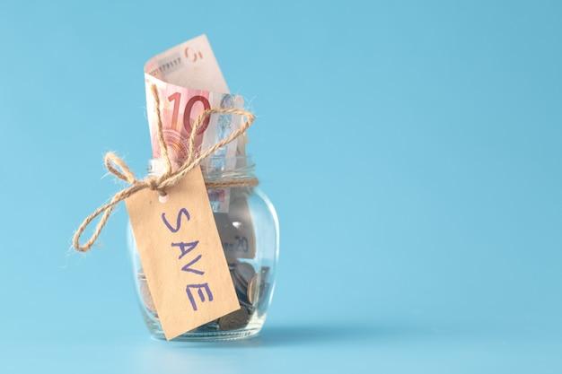 Coins in savings jar full of money