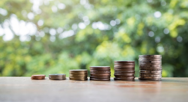 Coins stack, saving growing up money for business and financial concept idea