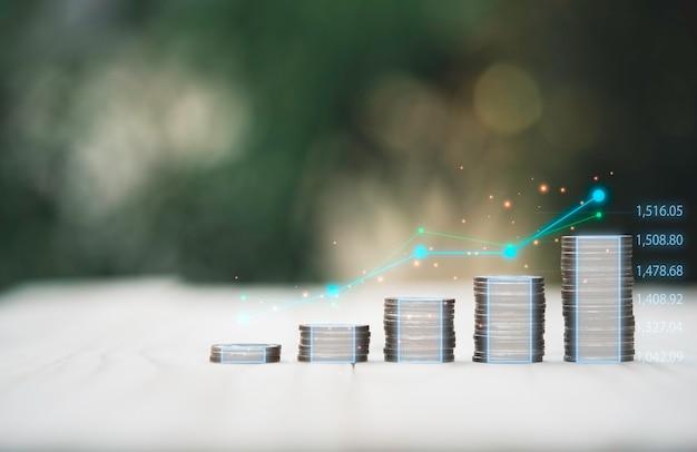 バリュー投資とトレーダーの概念のための仮想テクニカルグラフとスタックするコイン。