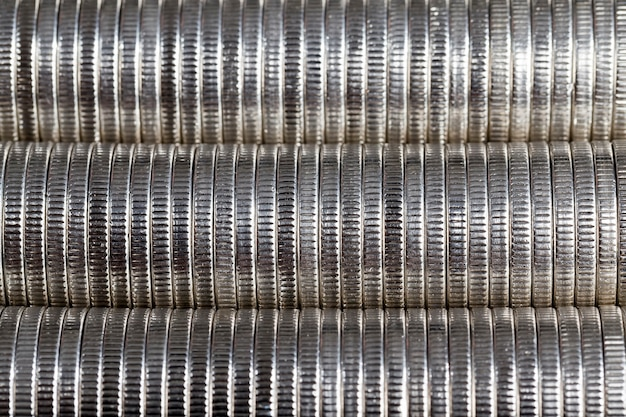 Coins with a silvery hue and made of metal alloys, close-up of coins is used as a legal means of payment, coins have defects after their use