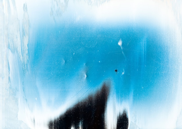 Cold abstract background. snow frame. blue white weathered surface with dust scratches grain noise ink brush strokes art pattern with center copy space.