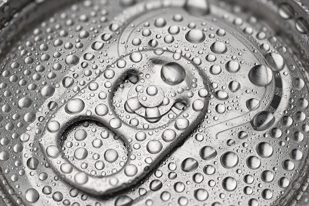 Cold aluminum can with water drops or dew close-up