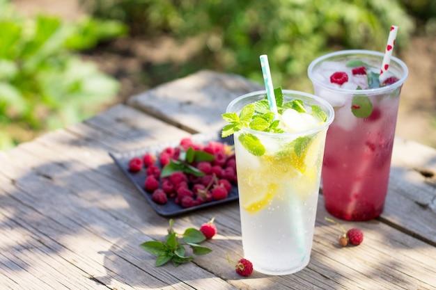 Cold beverage refreshing summer drink lemon refreshing summer drink raspberry with basil and ice