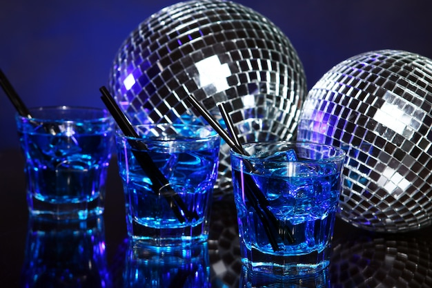 Cold blue cocktail with disco ball